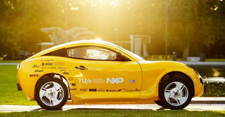 A Small Electric Car Made of Recycled Trash