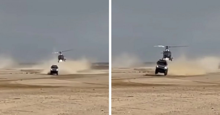 Dakar Rally Race Truck Hit by Low-Flying Helicopter