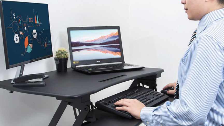 Boost Your Productivity and Posture with This Adjustable Desktop Riser