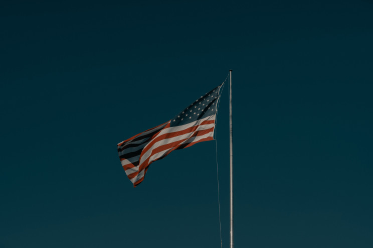 The American flag set against a dark blue background.