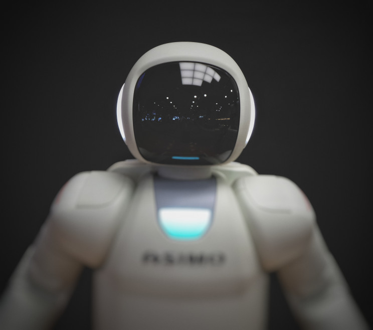 A robot with a black monitor on it's face.