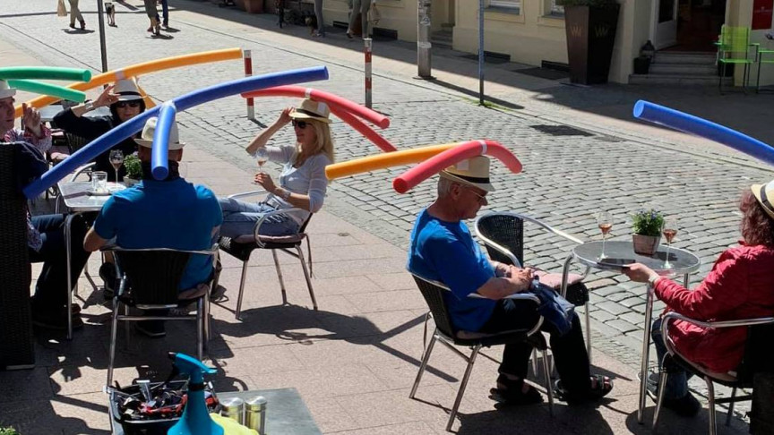 Image of article 'Pool Noodle Hats Are the New Way to Enforce Physical Distancing in Germany'