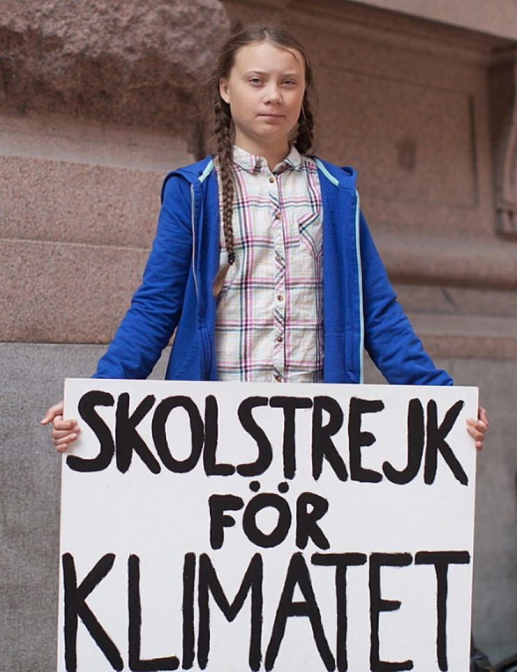 Greta Thunberg protesting at the Swedish Parliament