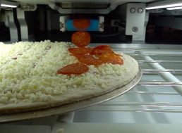 Pizza Robot Capable of Making 300 Pizzas Per Hour Served CES Attendees