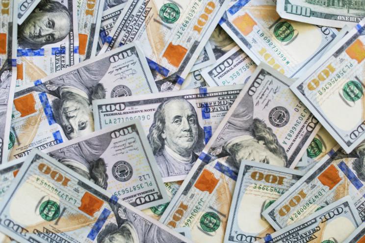 Image of money containing $100 bills