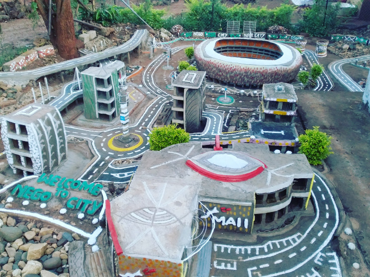 Man Spends 12 Years Building Johannesburg in His Backyard from Recycled Materials