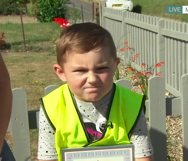 7-Year-Old 'Polices' Speeding Cars with a Scowl after His Cat Was Killed