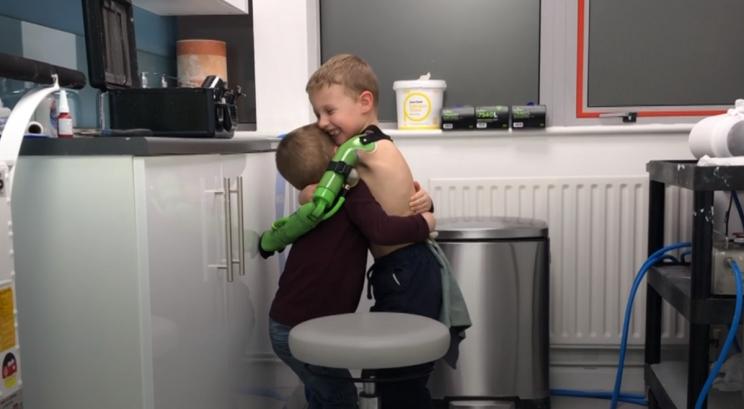 Jacob Scrimshaw hugging his brother