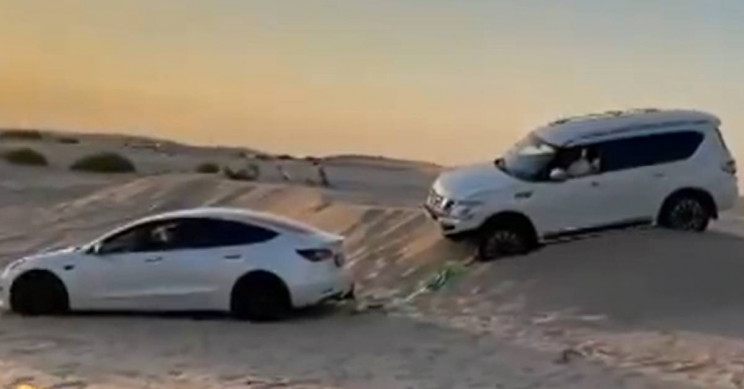 SUV Stuck in Dubai Dunes? Have a Tesla Model 3 Pull It Out