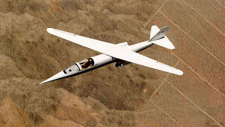 Cutting Through the Air With Scissor Wings: The NASA AD-1