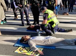 Australian Environmental Activists Glue Themselves to Busy Street in Protest