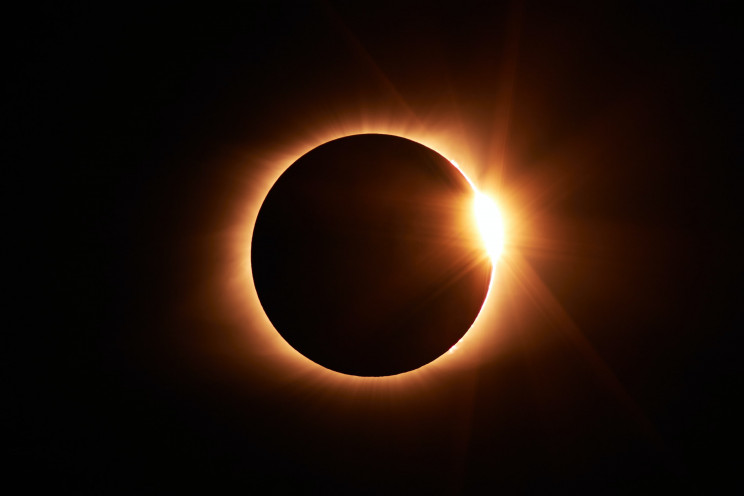 The moon blots out the sun in a solar eclipse.