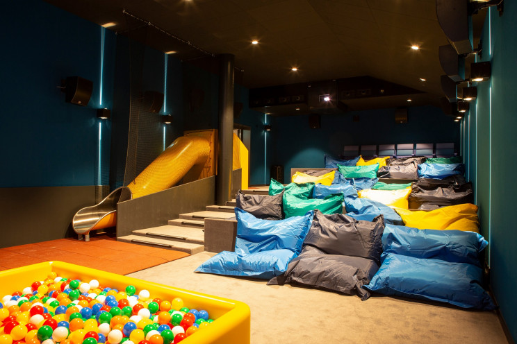 Swiss Movie Theater Offers Double Beds Seating for Ultimate Comfort