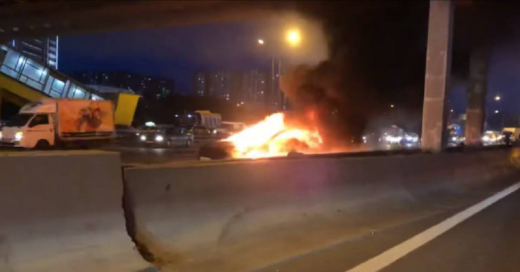 Tesla Model 3 hits parked truck and catches fire