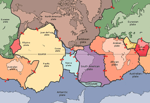 World map with tectonic plates drawn on top of it.