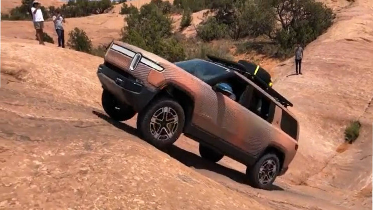 Watch as a Rivian R1S Performs a Steep Climb on a Rocky Hill