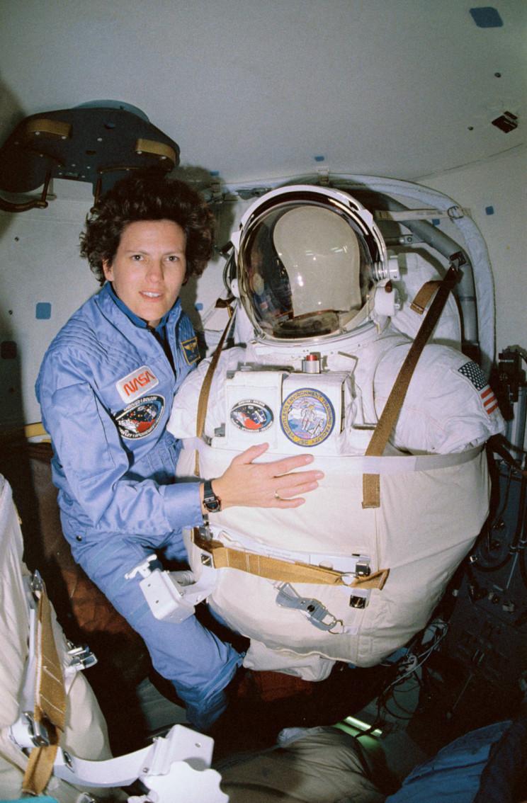 Kathryn Sullivan posing as she prepares for a potential third spacewalk.