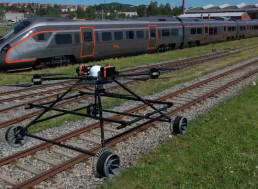 New Inspection Drone Rides the Tracks, Flies Away When a Train Appears