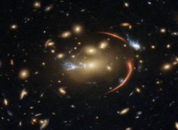 New Hubble Image Shows Gravity Bending Light and Magnifying a Distant Galaxy