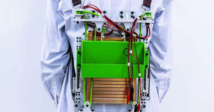 Load-Reducing Backpack Garners Energy from Walking To Power Electronics