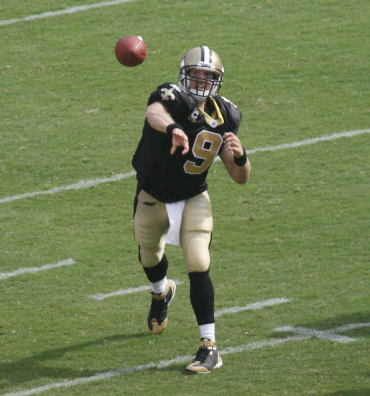Player Throwing Football