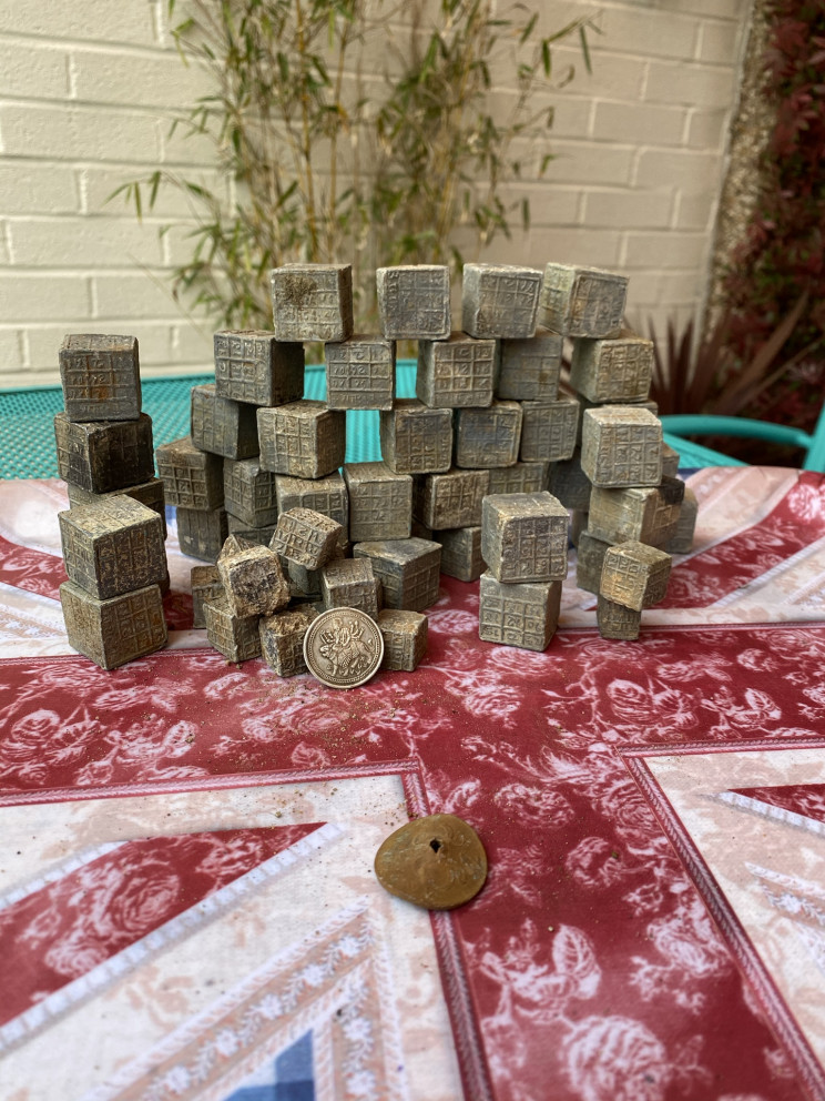 Magnet Fisherman Finds 60 Mysterious Cubes With Inscriptions in Coventry River