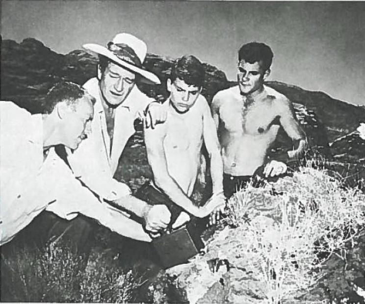 John Wayne using a Geiger counter
