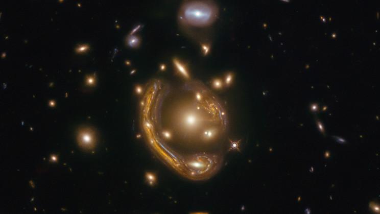 Molten 'Einstein Ring' Offers Glimpse Into a Galaxy 9.4 Billion Light-Years Away