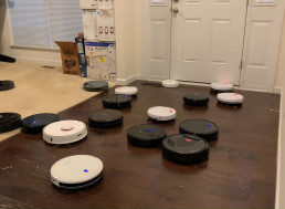 Watch 25 Robot Vacuums Attack A Bunch of Spilled Rice At Once