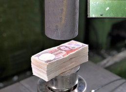 Watch a 150-Ton Hydraulic Press Test How Strong Money Really Is