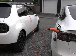 This E-Car Enthusiast Charges His Tesla Model 3 with a Honda E