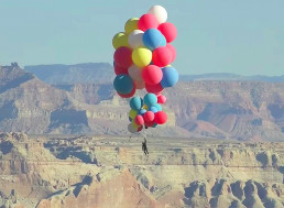 David Blaine Flies 25,000 Feet into the Sky Using 52 Helium Balloons