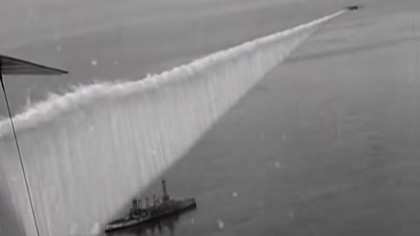 Military Plane Drops a Smokescreen to Hide Ships in 1923 Footage