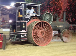 Steam Engine Tractor Drives Along with Burning Embers Flying from its Smokestack