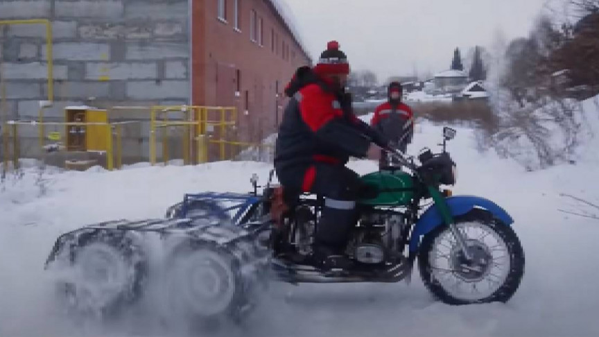 Mechanics Turn Simple Motorcycle Into Five-Wheeler Snowmobile