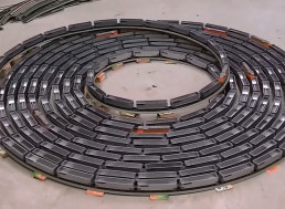 Watch Mesmerizing Model Train Turn Around in an Endless Spiral