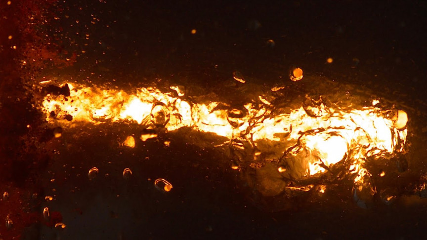 Watch 3632ºF Molten Thermite Land in Water in Slow Motion