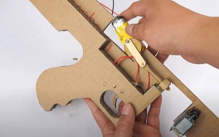 diy cardboard tommy gun firing assembly in place