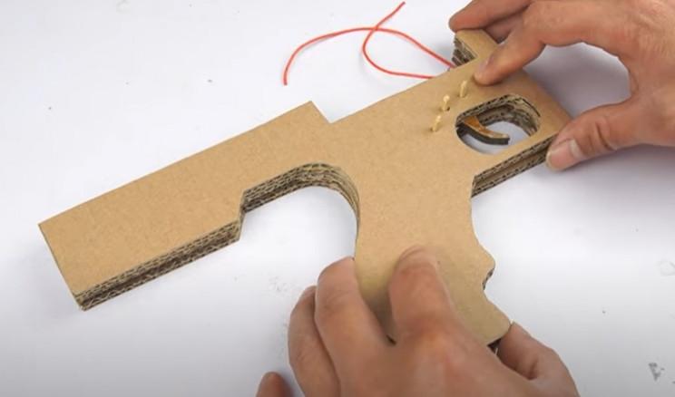 diy cardboard tommy gun close body