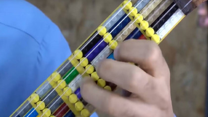 Watch a Man Build a Microtonal Guitar with a Colorful Lego Fretboard