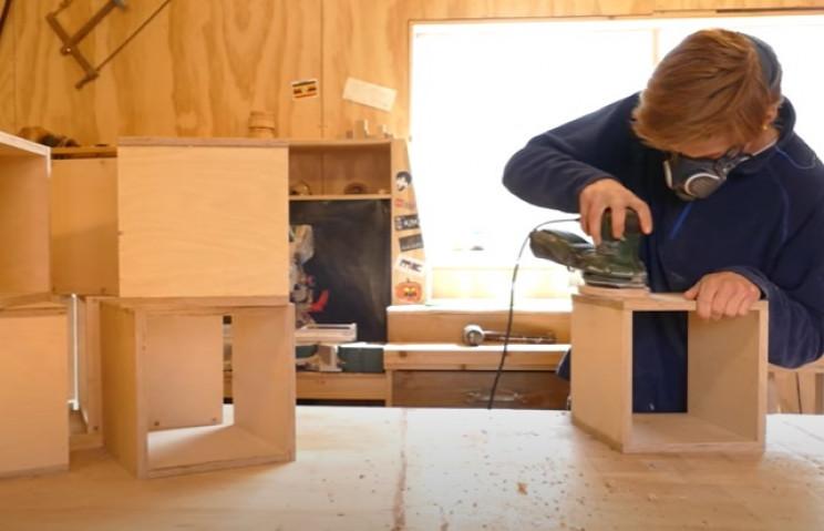 diy transforming bookshelf sanding