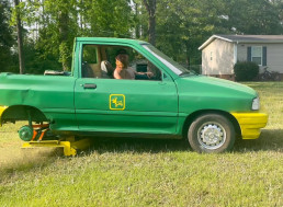 Getting Sunburns While Tending the Lawn? Attach a Mower to the Back of a Ford Festiva