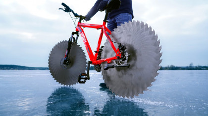 Craftsman Attaches Saws to His Bicycle, Rides it Over a Frozen Lake