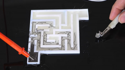 Making Self-Assembling Wires That Find Their Way Through a Maze