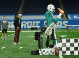 Robotic Kicker Takes on the World's Best Football Kicker