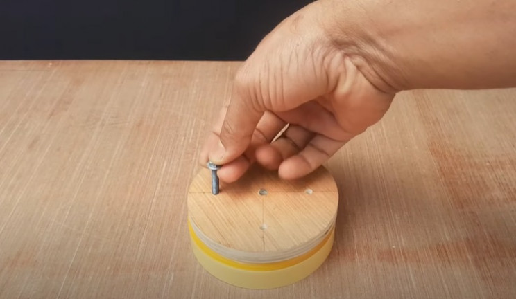 lid for a cup for cooking alone and a wooden disk
