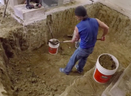 Watch a Man Dig out a 100-Year-Old Basement With His Bare Hands