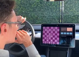 Tesla Model 3 Head to Head in Chess Match against Chess Prodigy, Fabiano Caruana