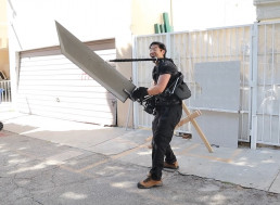 Watch This Guy Use an Exoskeleton to Lift a 50 Pound Sword