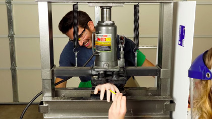 Engineer Tricks His Brain Into Believing His Hand Is Being Crushed By a Hydraulic Press